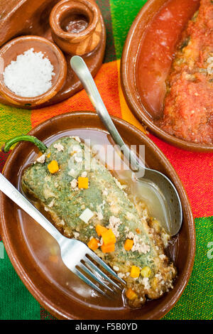 Stuffed peppers or chiles rellenos at a restaurant in Suchitlan, Colima, Mexico. - Stock Photo