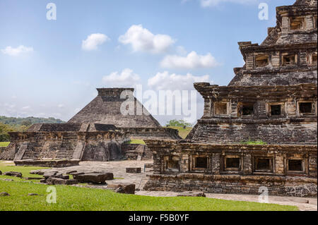 Building 5 in the distance and the Niches Pyramid at the Tajin, Veracruz ruins in Mexico. - Stock Photo