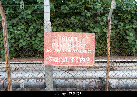Red no entry sign with chinese - Stock Photo