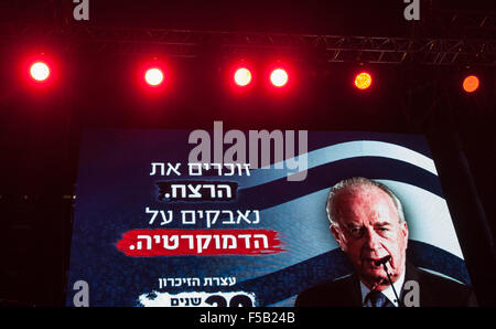 Tel Aviv. 31st Oct, 2015. Portrait of former Israeli Prime Minister Yitzhak Rabin is displayed on a big screen during - Stock Photo