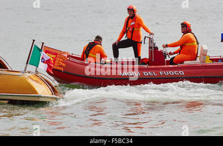 Divers from the Vigili Del Fuoco Italy's agency for fire and rescue service on a boat in the Grand Canal Venice Veneto Italy