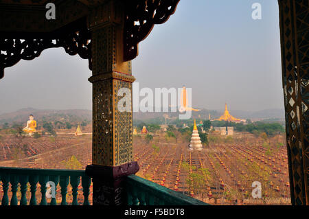 Tower in the The Ten Thousand Buddha Garden overlooking the second tallest Buddha statue in the world at Bodhi Tataung,Myanmar - Stock Photo