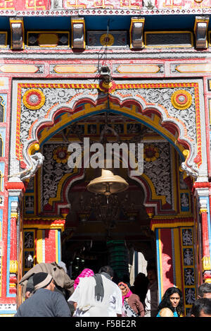 Many pilgrims are gathering in front of the colourful Badrinath Temple, one of the Char Dham destinations, Badrinath,Uttrakhand - Stock Photo