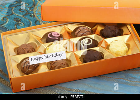 happy birthday card with box of assorted chocolates stock photo, Birthday card