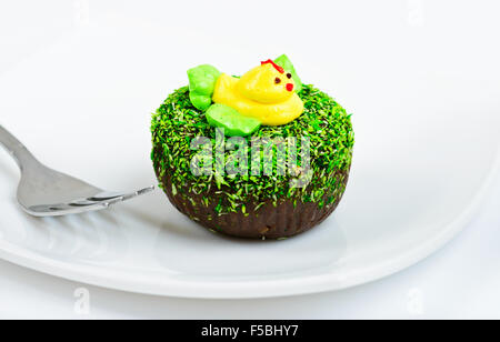Chocolate cake decorated with duck on white dish - Stock Photo