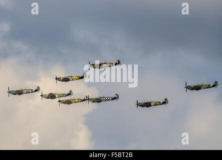 A formation of Spitfires at a UK airshow. Second World War Spitfire fighter plane formation to mark 75th anniversary - Stock Photo