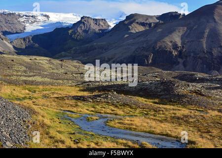 Stream running from the Oraefajokull glacier in Vatnajokull National Park - Stock Photo