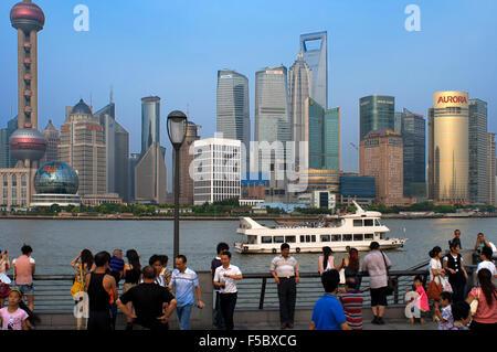 The Bund promenade, Shanghai, China. China Shanghai Tourist Shanghai Skyline viewed over the Huangpu river from - Stock Photo