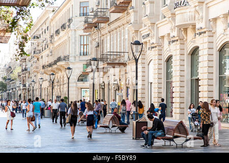 Pedestrians on Nizami street in central Baku. The street is named after classical poet Nizami Ganjavi. - Stock Photo