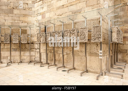 Fragments of the stone frieze of the Bayil Fortress in the Palace of the Shirvanshahs, in Baku, the capital of Azerbaijan. - Stock Photo