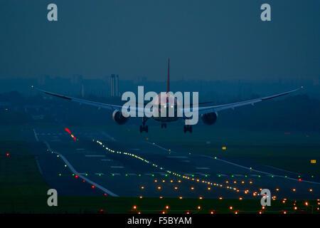 Air India Boeing 787 Dreamliner landing at dusk, Birmingham Airport. UK - Stock Photo