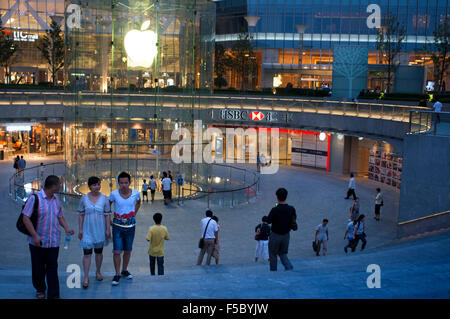 Apple computer store in Lujiazui financial district, in Pudong, in Shanghai, China. View of large modern Apple store - Stock Photo