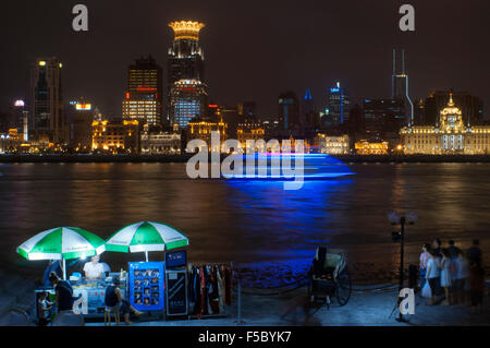 The bund on the night and the Huangpu river. The Bund promenade, Shanghai, China. China Shanghai Tourist Shanghai - Stock Photo