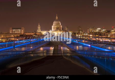 St Pauls Cathedral and the Millennium  Bridge at night - Stock Photo