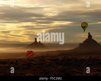 Hot air balloons over the Valley of the Gods during the Annual Bluff International Balloon Festival near Bluff, - Stock Photo
