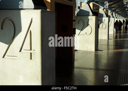 Numbered bus terminals entrances in Nils Ericson bas station in Göthenburg, Sweden - Stock Photo