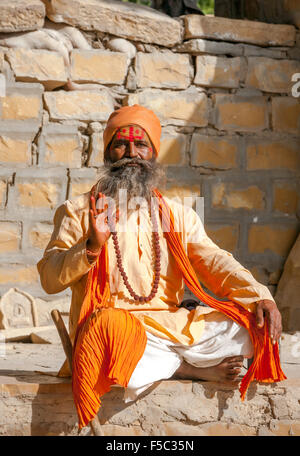 JAISALMER, RAJASTHAN, INDIA - NOVEMBER 28, 2012: Holy Sadhu man with traditional painted face - Stock Photo