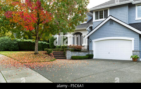 Detached house USA - large single family modern USA house with trees and lawn in Autumn season - Stock Photo