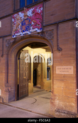 The main entry to Sherborne School, which was re-founded in the reign of King Edward 6th. His coat of arms is above - Stock Photo