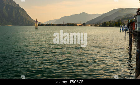 In the picture a view of Lake Iseo from the city of Lovere, on the side left of a sailboat. - Stock Photo