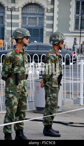 Two People's Liberation Army unformed soldiers stand guard around Tiananmen Square Beijing China - Stock Photo