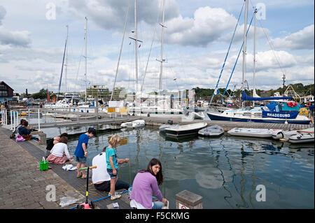 crabbing holiday fun quayside lymington hampshire - Stock Photo