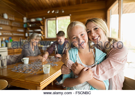 Mother and daughter hugging in cabin - Stock Photo