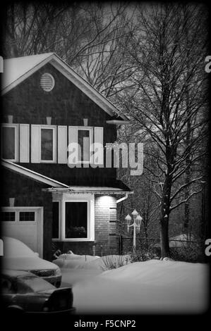 Front yard of a two-storey house covered with snow in Toronto suburbs - Stock Photo