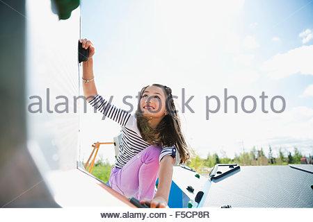 Girl climbing at sunny playground - Stock Photo