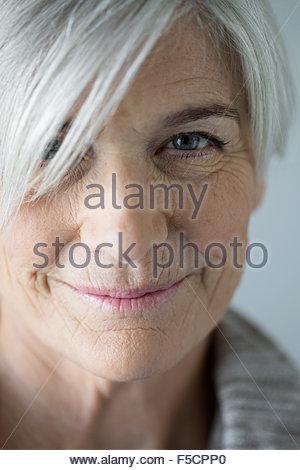 Close up portrait smiling senior woman - Stock Photo