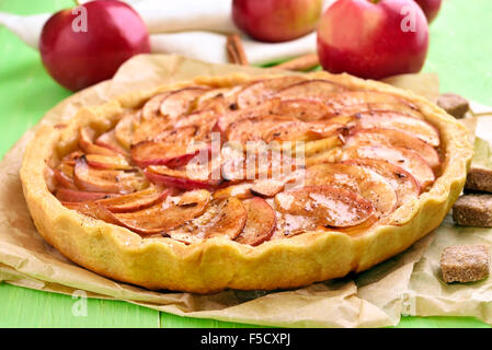 Apple pie on baking paper, close up view - Stock Photo