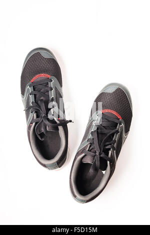 New unbranded running shoe color black and red, sneaker or trainer isolated on white background - Stock Photo