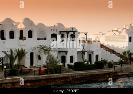 Luxury egyptian apartments at sunset. - Stock Photo