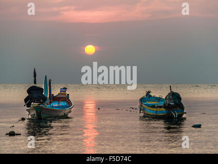 Two long-tail boats, South China Sea at sunset, Gulf of Thailand, Koh Tao, Thailand - Stock Photo