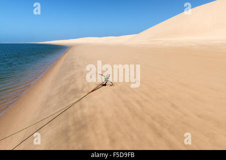Anchor of a fishing boat at the beach of Lagoon Khenifiss (Lac Naila). - Stock Photo