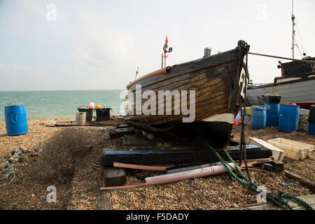 Scenic landscape of lovingly oiled fishing wooden fishing boat on a shingled beach - Stock Photo