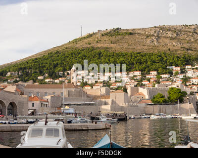 Late afternoon in the old harbour of Dubrovnik Croatia, golden light on the mountain top outside the walls - Stock Photo