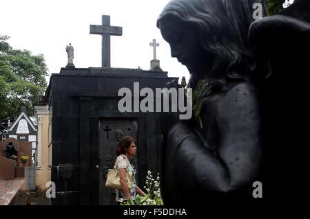 Sao Paulo, Brazil. 2nd Nov, 2015. A woman walks in Araca Cemetery during 'The Day of Dead', in Sao Paulo, Brazil, - Stock Photo