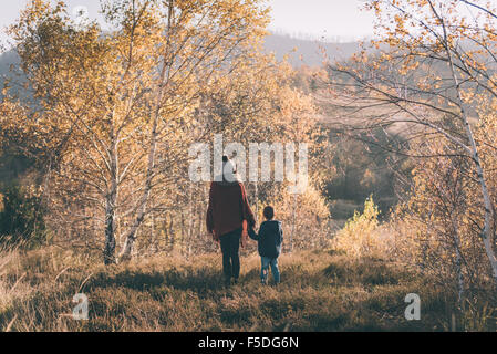 Woman and her son in nature. - Stock Photo