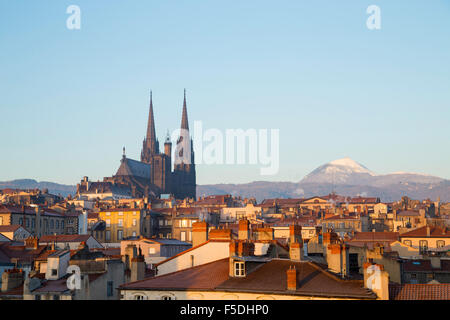 Roof top view of city center and volcano Puy de dome in Clermont ferrand, Auvergne, France - Stock Photo