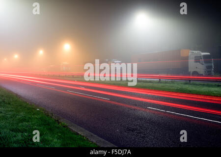 Hucknall, Nottinghamshire, UK:02nd November 2015 Dense fog remains to night around the east Midlands area, set to clear some time during Tuesday .Trucker's parked overnight J27 M1. Credit:  IFIMAGE/Alamy Live News