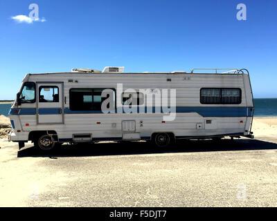 Old Retro Vintage Camper With Blue Sky