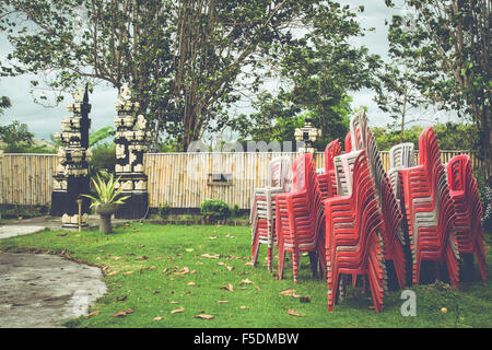 Large stack of plastic chairs in Indonesia. - Stock Photo