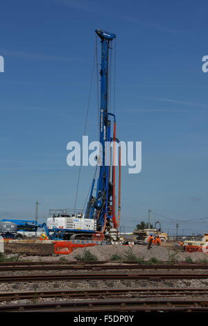A very tall machine for boring deep holes into the ground in order to fill the void with steel reinforced concrete - Stock Photo