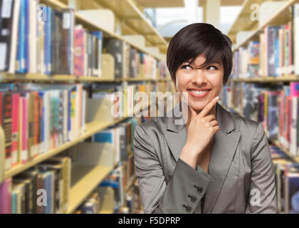 Curious Mixed Race Girl Looking to the Side in the Library. - Stock Photo