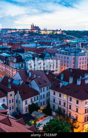 View over the Old Town rooftops towards St. Vitus's Cathedral at dusk, UNESCO World Heritage Site, Prague, Czech - Stock Photo