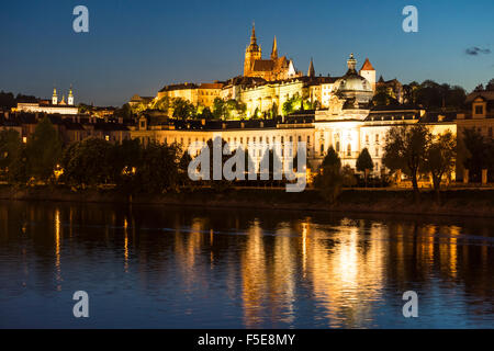 St. Vitus's Cathedral and Prague Castle illuminated at dusk, UNESCO World Heritage Site, Prague, Czech Republic, - Stock Photo