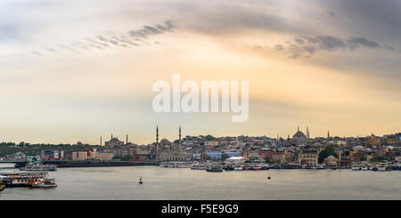 Hagia Sophia and New Mosque seen across Golden Horn at sunset, Istanbul, Turkey, Europe - Stock Photo