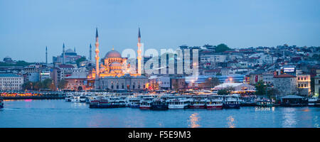 New Mosque (Yeni Cami) on the banks of the Golden Horn at night with Hagia Sophia (Aya Sofya) behind, Istanbul, - Stock Photo