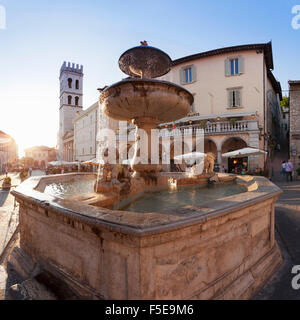 Fountain with Santa Maria sopra Minerva Church, Piazza del Comune Square, Assisi, Perugia District, Umbria, Italy, - Stock Photo